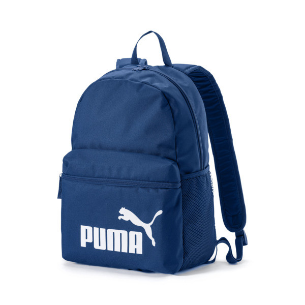 Designed with the modern athlete in mind, the Phase Backpack is both stylish and functional. The classic design features a roomy main compartment that opens via a two-way zip and padded adjustable straps so you can go through your day in style and comfort. | PUMA Phase Backpack in Blue