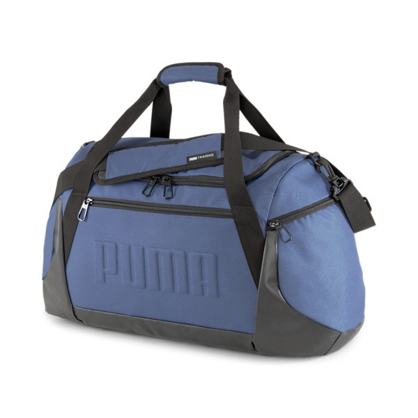 Featuring a sleek design, this spacious duffel will carry all your essentials through the day. With details like a shoe compartment, an inner slip pocket and adjustable straps for carry options, this bag will surely become your go-to fave. The 3D embossed PUMA Wordmark on the front adds stylish depth.   PUMA Gym Duffel Bag in Dark Denim