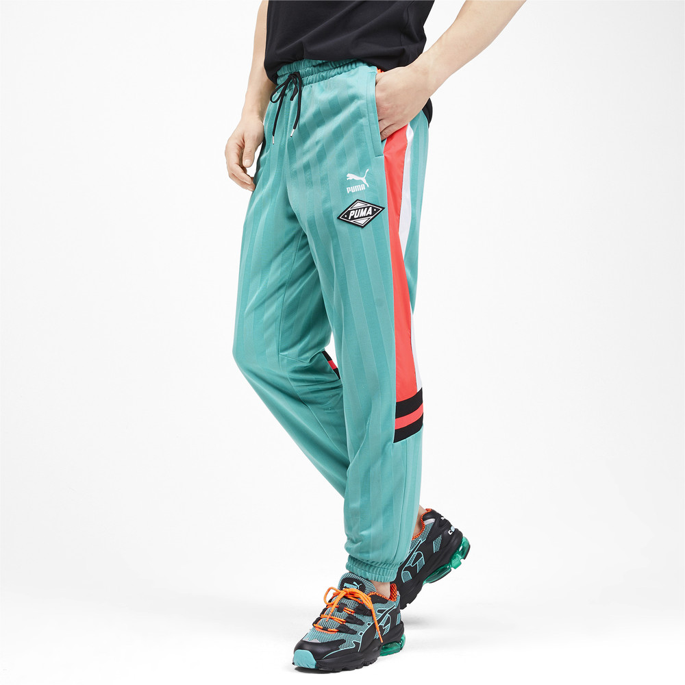 Image Puma luXTG Woven Knitted Men's Pants #1
